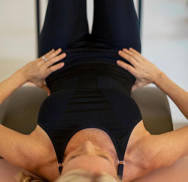 woman in pebbles pilates jumpsuit