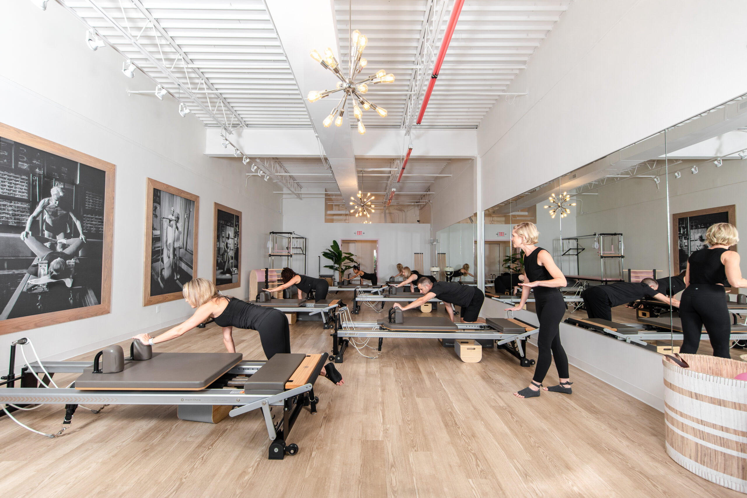 woman and men in pilates reformer class